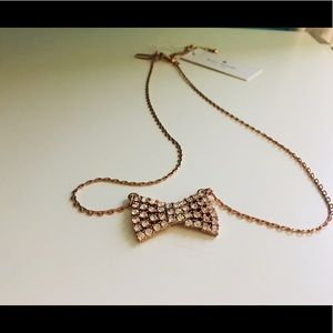 Kate Spade Sparkling bow pendant Rose gold